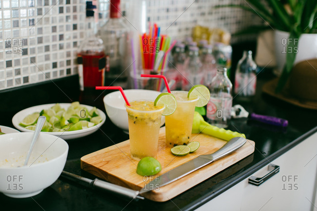 Fresh sliced limes to garnish passion fruit cocktail