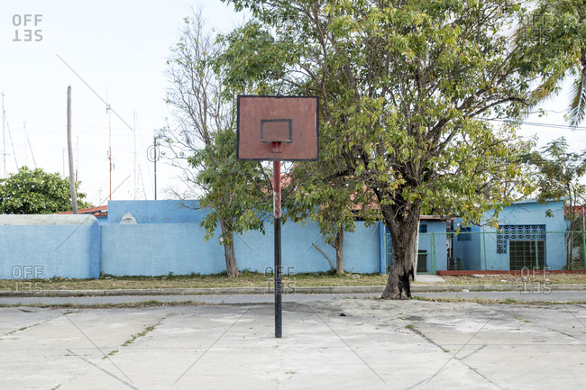 Deserted basketball court with rusted backboard in Cienfuegos, Cuba