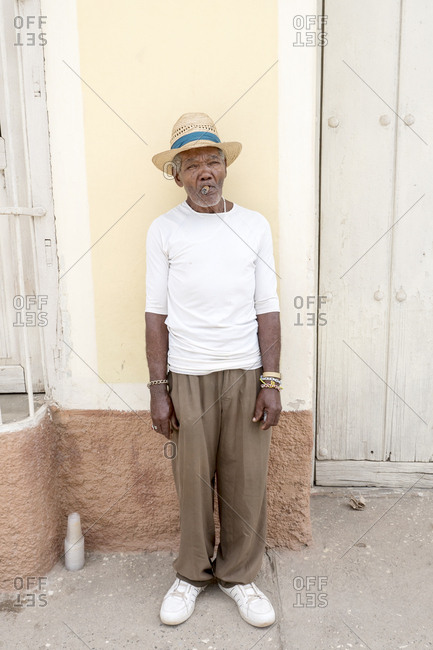 Trinidad, Cuba - February 27, 2015: Portrait of elderly Cuban man smoking with cigar in his mouth