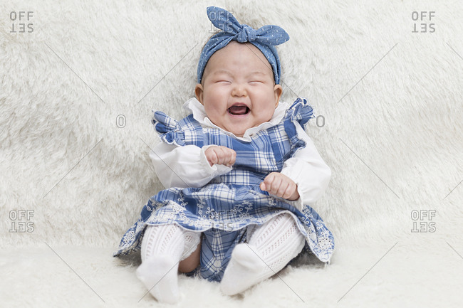 A smiling baby celebrates Baek-il, its 100th day milestone