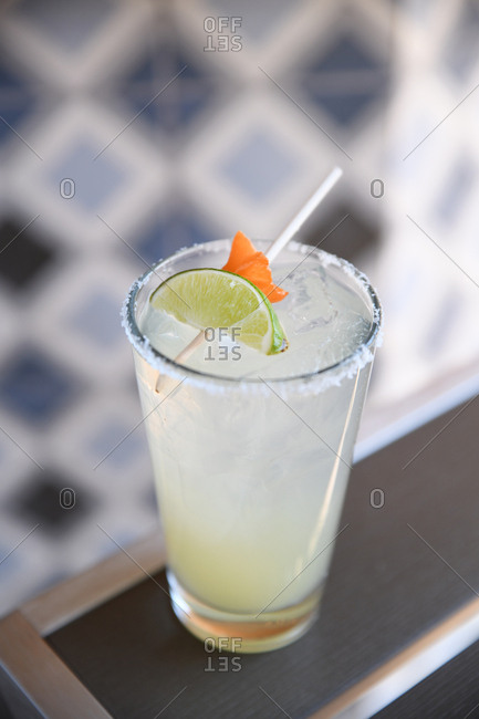 Cocktail garnished with a lime and star fruit