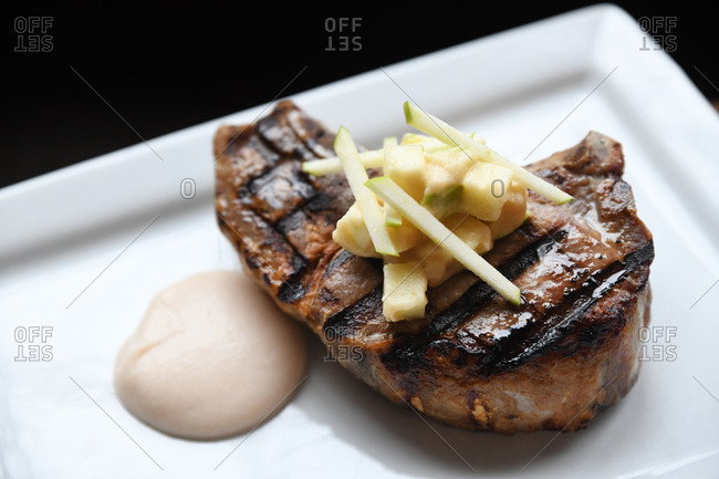 Steak topped with apples