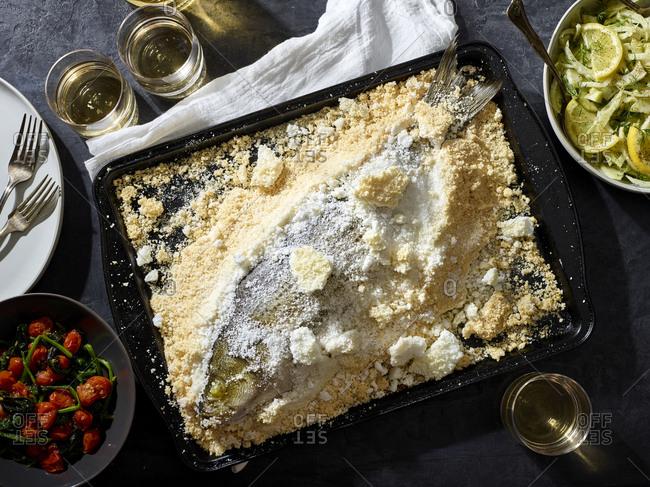 Salt baked sea bass with salads