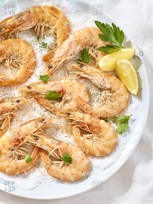 Overhead view of shrimp on a bed of salt