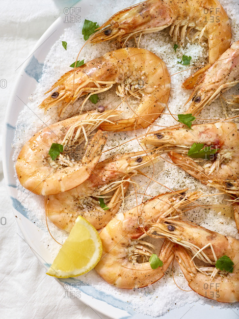 Detail of whole salt baked shrimp on a bed of salt