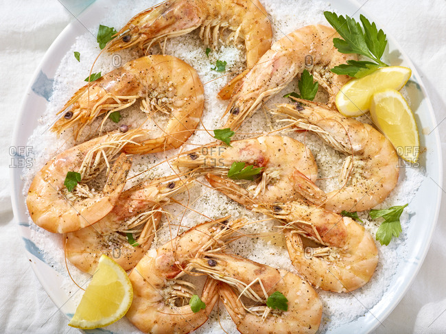 Overhead view of salt baked shrimp on a bed of salt