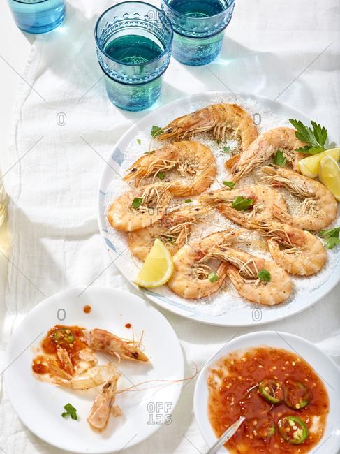 Meal of salt baked whole shrimp and salsa