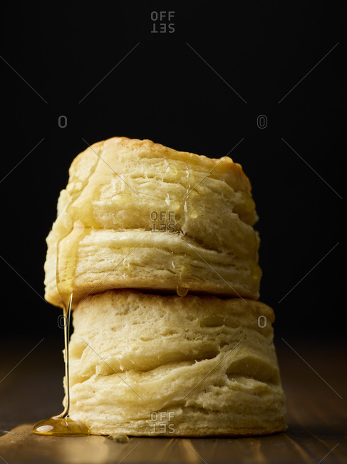Stuck of buttermilk biscuits covered in honey