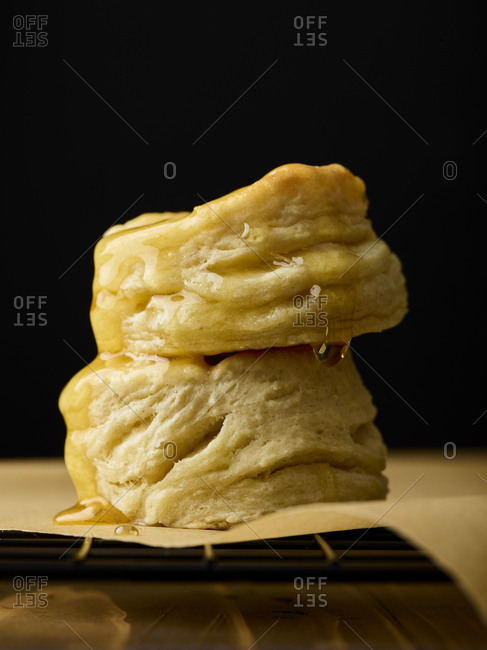 Stack of buttermilk biscuits drizzled with honey