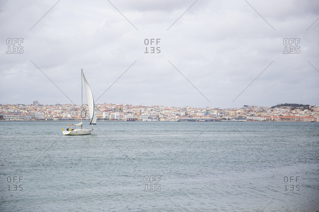 Sailboat on the Tejus river in Lisbon, Portugal.