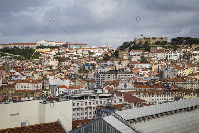 March 28, 2016: A view of the city rooftops looking towards the castle in Lisbon, Portugal.