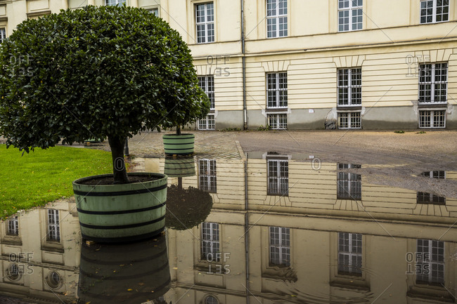 October 8, 2017: Part of Schloss Charlottenburg reflected in a puddle in Berlin, Germany.