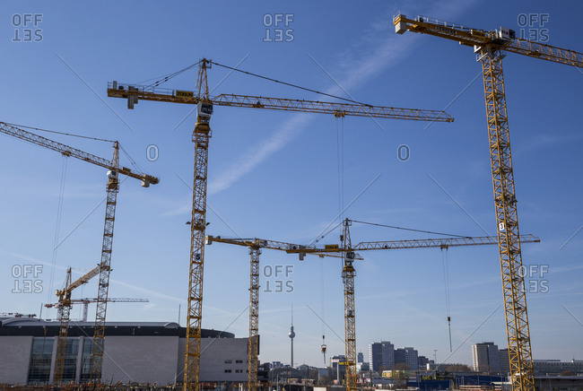 March 28, 2017: Cranes at a construction site at Warschauer Strasse in Berlin, Germany.