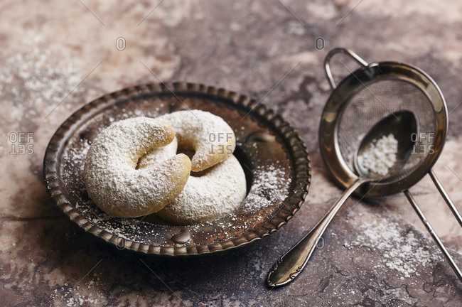 Traditional german vanilla crescent cookies (Vanillekipferl) for christmas  on a vintage marble surface
