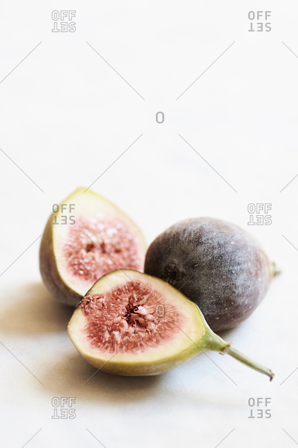 Fresh figs on a light marble surface