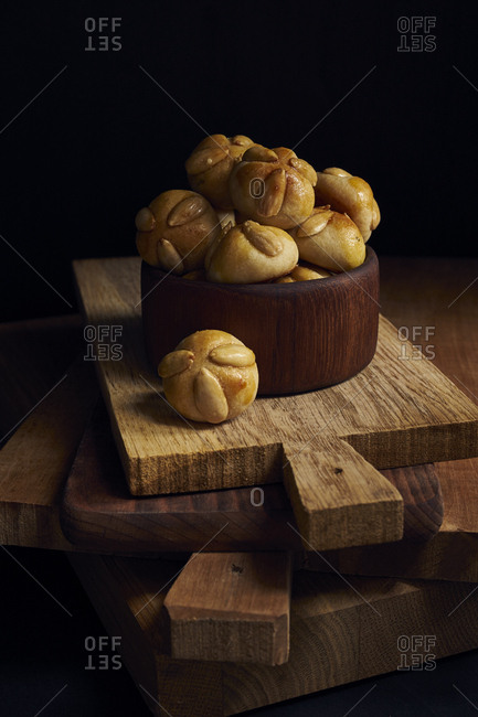 Traditional german marzipan pastries with almonds (Bethmannchen) in wooden bowl for christmas