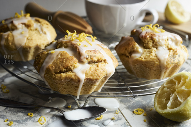 Lemon parsnip muffins with lemon icing sprinkled with lemon zests