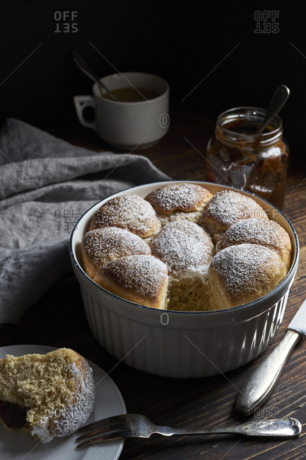Homemade sweet yeast dough buns filled with prune plum jam, traditional german and austrian pastry