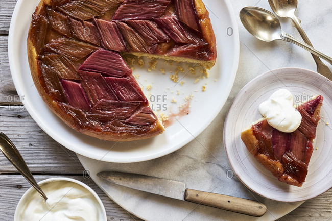 Overhead view of homemade rhubarb tarte tatin with one piece removed