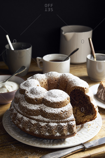 Homemade marble caramel bundt cake on rustic table with slices missing