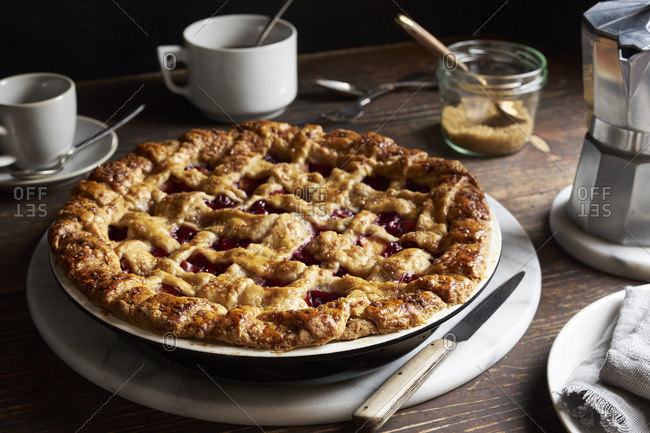 Homemade nectarine and red currant pie on dark wooden table