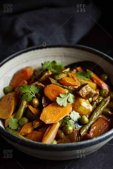 Red vegetable curry with eggplant, carrots, beans and peas