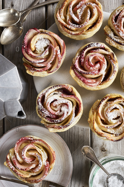 Homemade apple tarts in rose shape sprinkled with powdered sugar