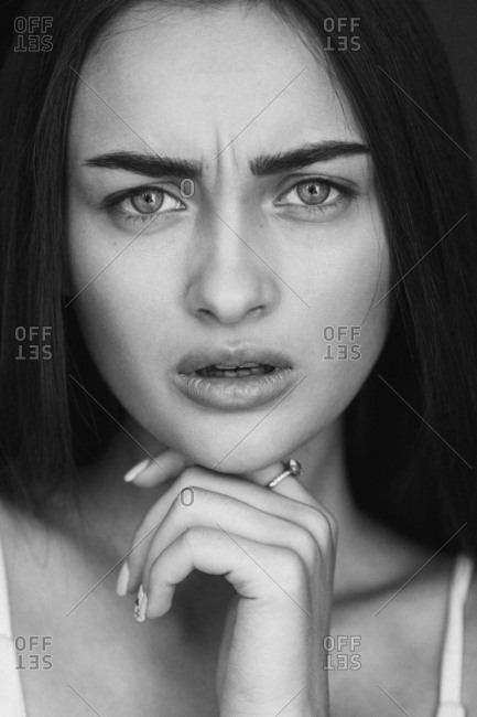 Close-up portrait of confused young woman
