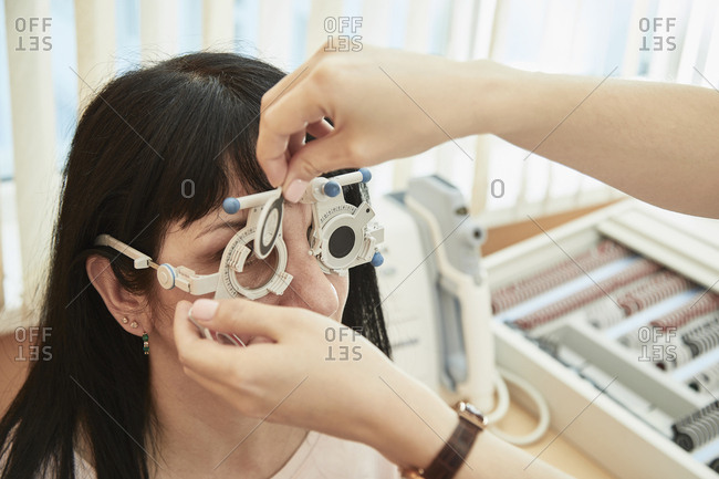 Cropped image of optometrist examining woman's vision at clinic
