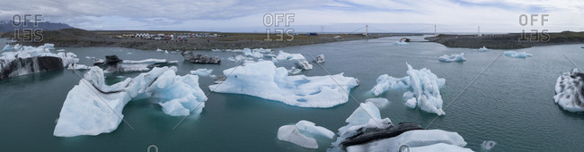 Panoramic view of icebergs in water against sky, Jokulsarlon, Iceland