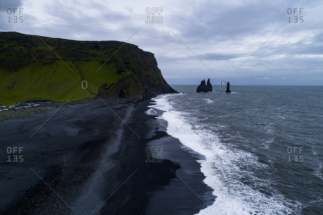 Scenic view of beach against cloudy sky, Iceland