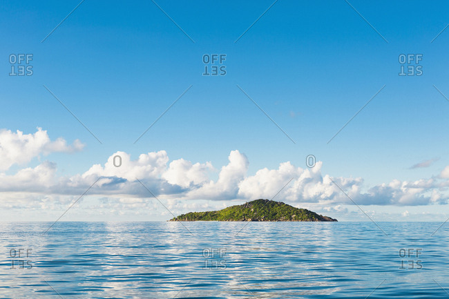 Scenic view of seascape against blue sky, Island of Petite Soeur, Seychelles