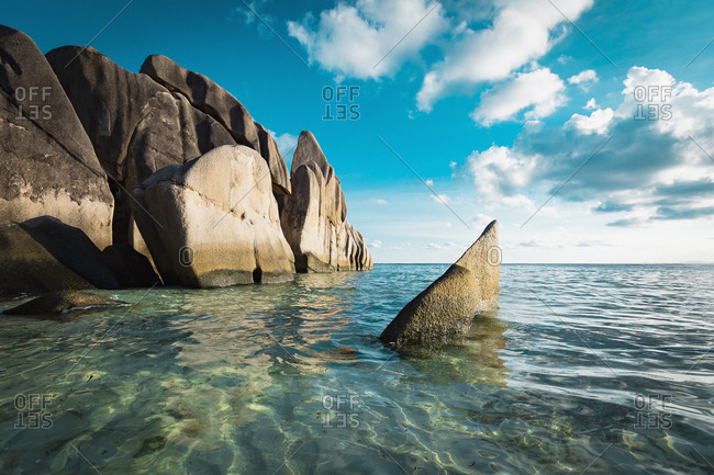 Scenic view of rocks in sea against sky, Island of La Digue, Seychelles