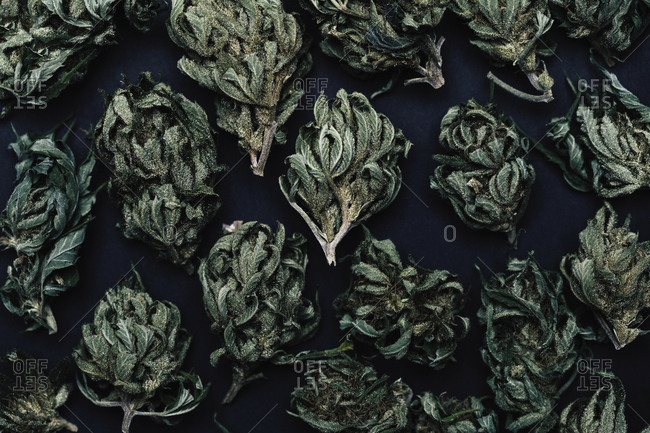 Full frame shot of dried marijuana leaves on table