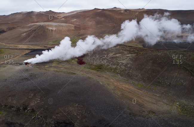 Drone view of smoke from containers on landscape, Myvatn, Iceland