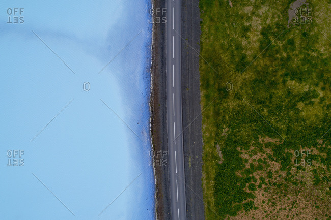 Aerial view of road amidst field and water, Myvatn, Iceland