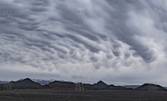Idyllic shot of landscape against cloudy sky, Iceland