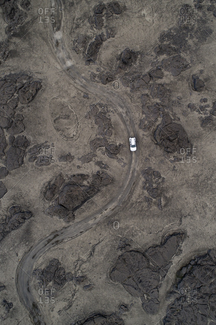 Aerial view of car on dirt road over barren landscape, Kverkfjoll, Iceland