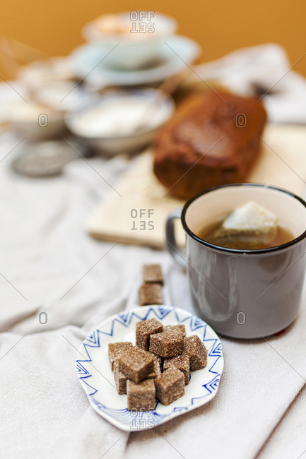 Tea with brown sugar cubes