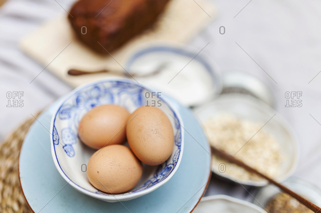 Eggs and other ingredients gathered for a cake recipe