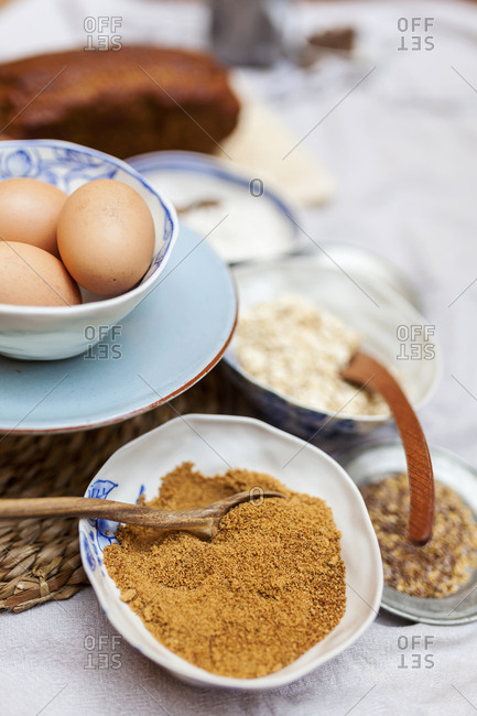 Eggs, brown sugar and other ingredients gathered for a cake recipe