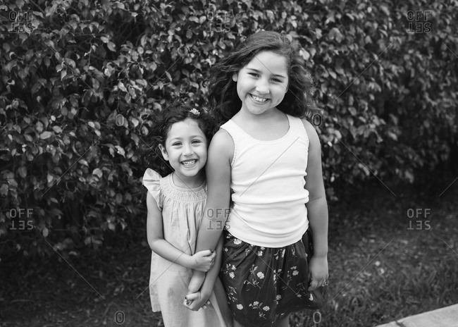 Black and white portrait of two young girls outdoors