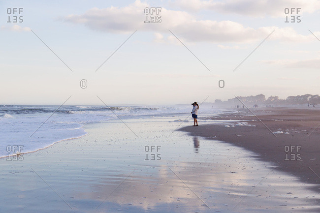 Photographer shooting on beach, Amelia Island, Florida