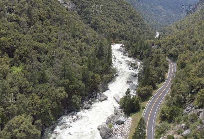 Aerial view of road running alongside Merced River near Yosemite National Park, California