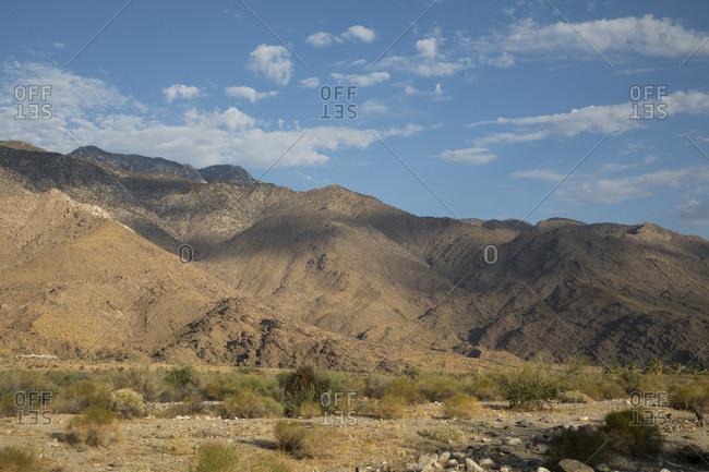 Arid hills rising out of the desert floor near Palm Springs, California