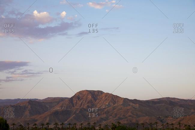 Rising sun illuminating hills in desert near Palm Springs, California
