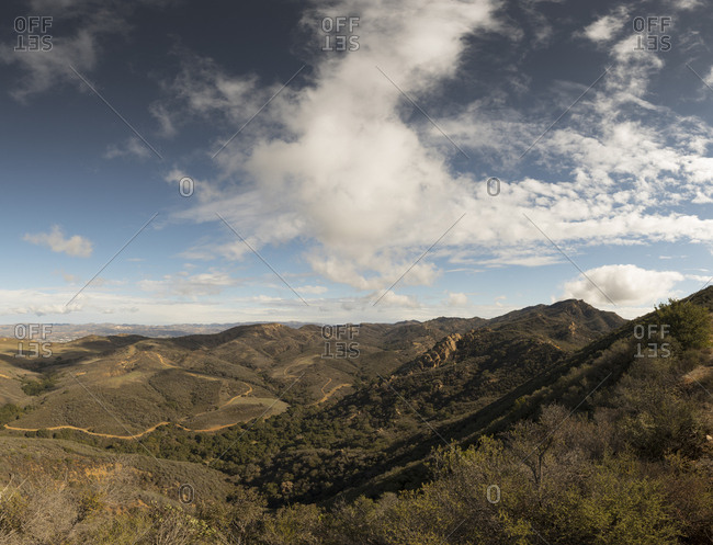 Looking down into lush green valley while hiking in the hills of California