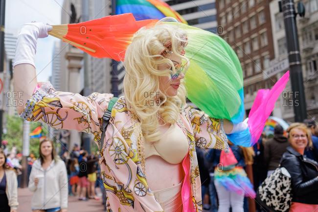 San Francisco, California, USA - June 25, 2017: Person waving rainbow flag at San Francisco Pride Parade