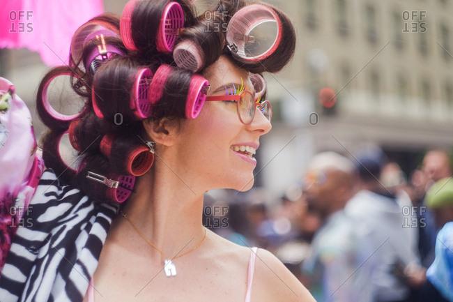 San Francisco, California, USA - June 25, 2017: Portrait of a smiling person wearing hair curlers at San Francisco Pride Parade