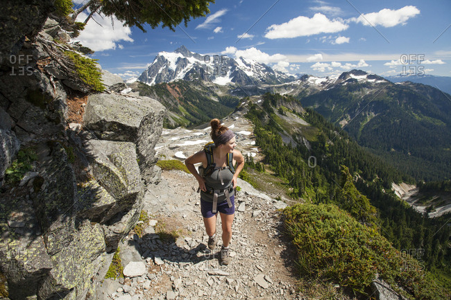 Female hiker walking on mountain at North Cascades National Park